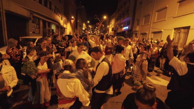 vidéos et rushes de singing and dancing at nighttime traditional festival - portugal - femmes d'âge moyen