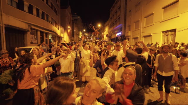 singing and dancing at nighttime traditional festival - portugal - street party stock videos & royalty-free footage