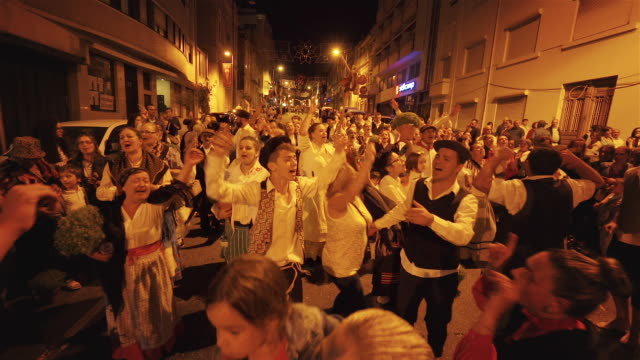 singing and dancing at nighttime traditional festival - portugal - traditional festival stock videos & royalty-free footage