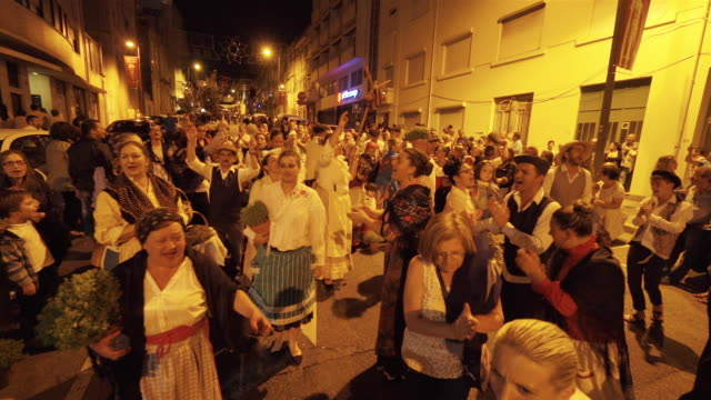 singing and dancing at nighttime traditional festival - portugal - porto district portugal stock videos & royalty-free footage