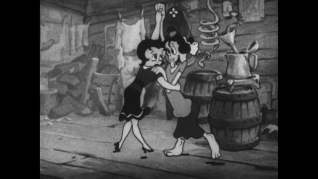 vidéos et rushes de a singing backwoods family offers betty boop help - surprise