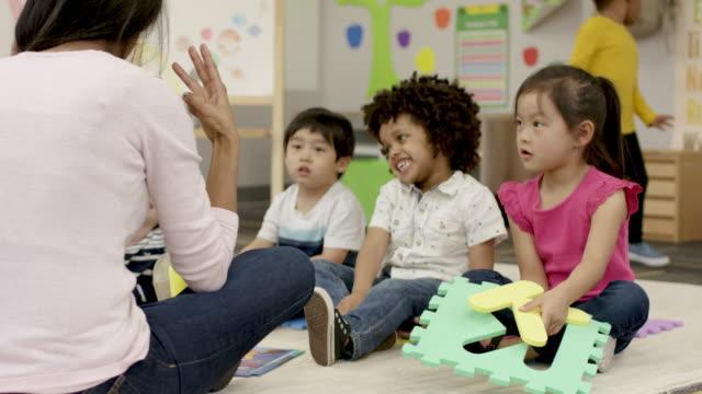 singing songs in pre-school - fatcamera stock videos & royalty-free footage