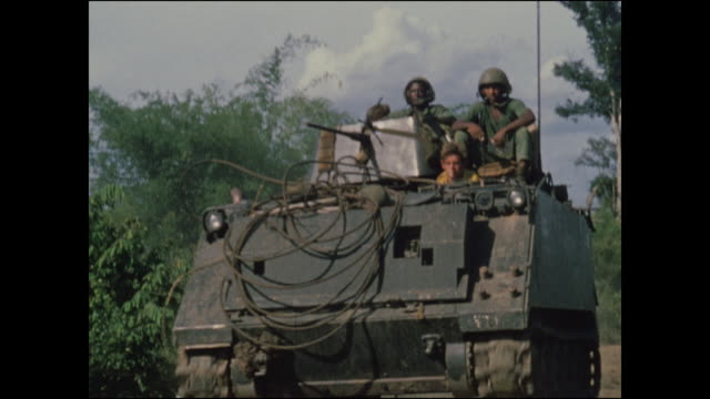 vídeos de stock e filmes b-roll de single apc starts crossing and becomes huge, filling the frame and then passing out of it. photographer was very close. 2 /47th mechanized infantry... - camboja