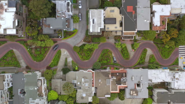 single black car driving down lombard street in san francisco during covid-19 pandemic - lombard street san francisco stock videos & royalty-free footage