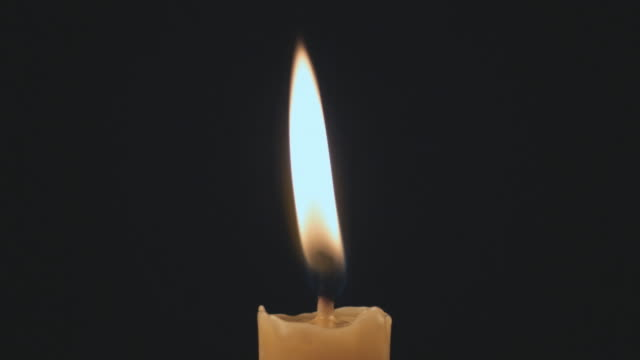 slo mo ecu single candle being blown out / auckland, new zealand - ローソク点の映像素材/bロール
