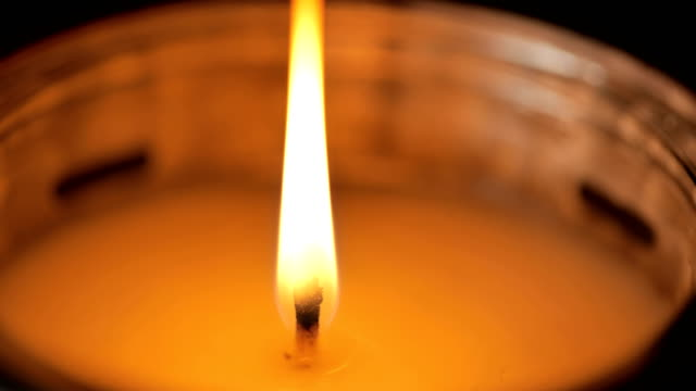 single candle flame: concept macro - candlelight stock videos & royalty-free footage