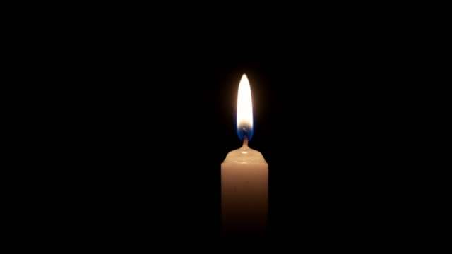 4k: single candle in dark - candle stock videos & royalty-free footage