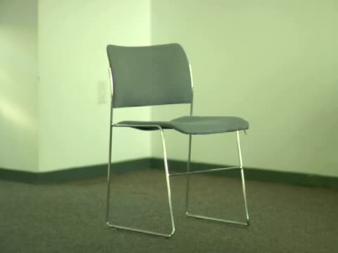 MS, Single chair standing in empty room