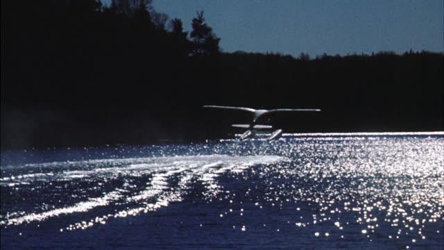 MS Single engine double pontoon seaplane taking off