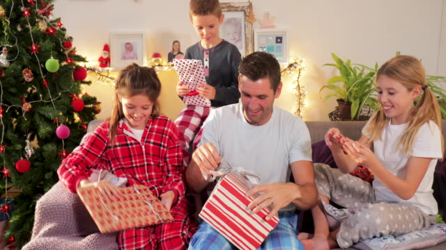 A Single Father and Children Opening Presents on Christmas