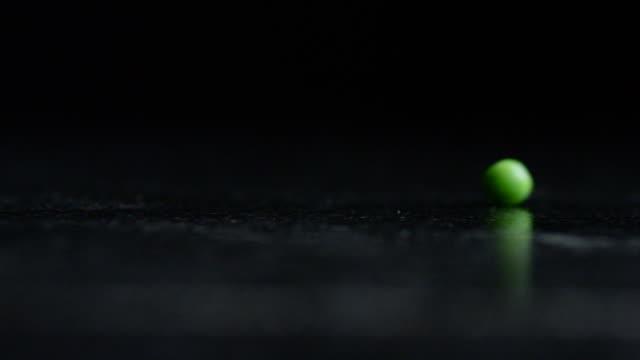 Single Green Peas Rolls into Frame