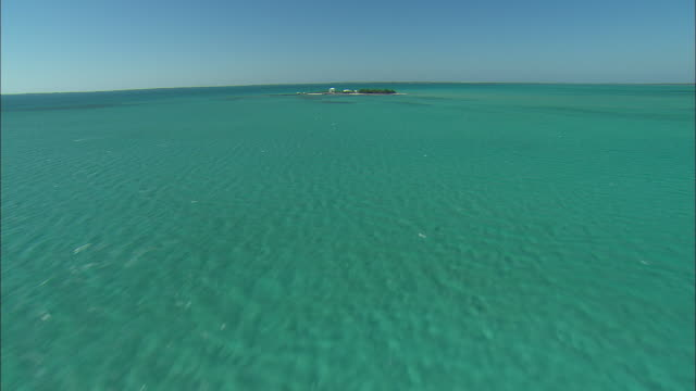 aerial single home on it's own island near spanish wells, bahamas - caribbean sea stock videos and b-roll footage