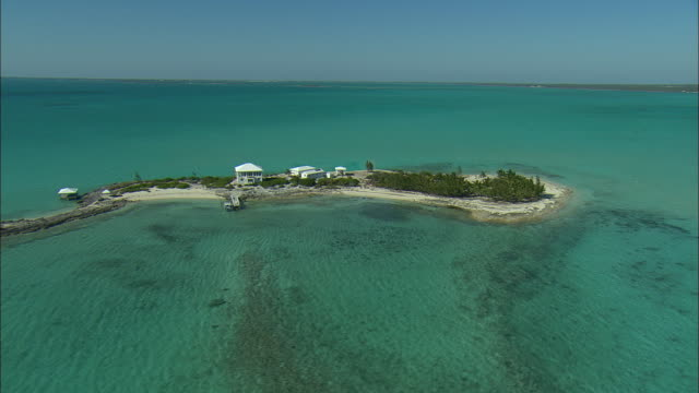 aerial single home on it's own island near spanish wells, bahamas - bahamas stock videos and b-roll footage