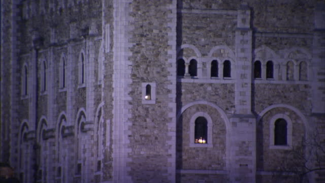 a single light shines through a window on the tower of london. - tower of london stock videos and b-roll footage