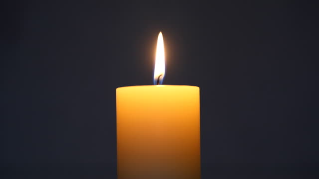 single lit candle - candlelight stock videos and b-roll footage