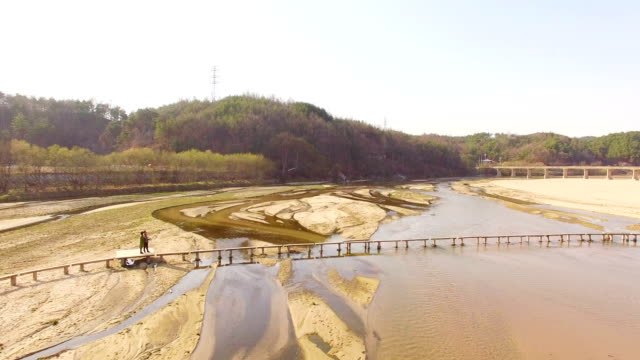 single log bridge at naeseongcheon stream in museommaeul village - log stock videos & royalty-free footage