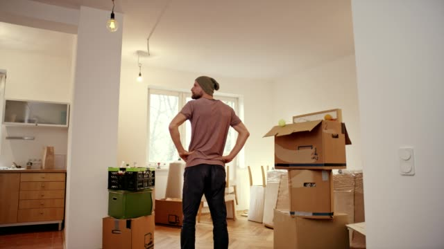 single man moving into new flat. - relocation stock videos & royalty-free footage