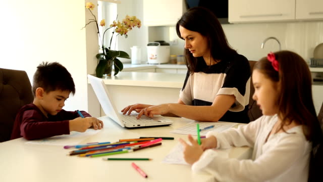 single mother with children working from home - teleworking stock videos & royalty-free footage