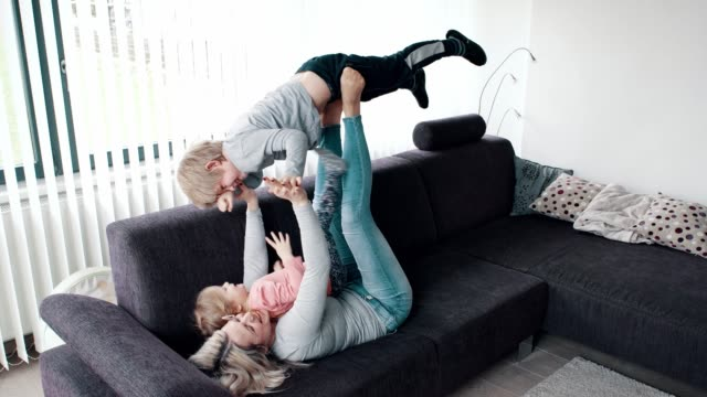 single mum playing with her children - balance stock videos and b-roll footage
