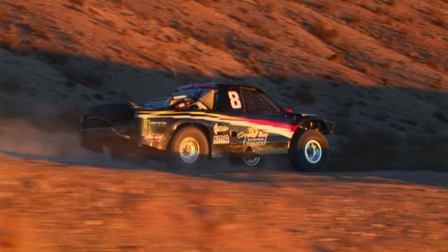 HA TS Single seat off-road trophy truck riding through desert ay sunset, Barstow, California, USA