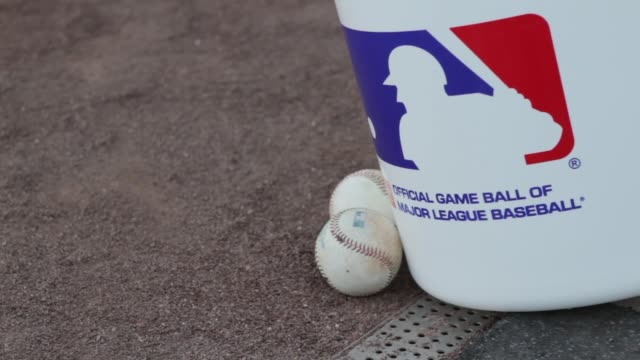 Single shot of a tub with the Major League Baseball logo next to some baseballs sitting in a baseball field MLB Logo on April 04 2012 in Los Angeles...