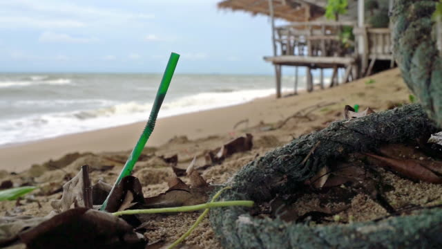 single use plastic ocean pollution discarded drinking straw - straw stock videos & royalty-free footage