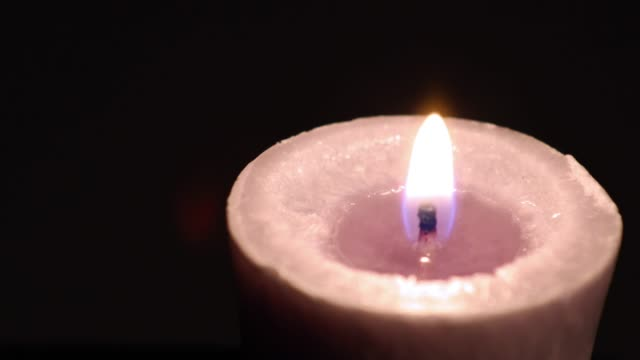 single votive candle - votive candle stock videos and b-roll footage