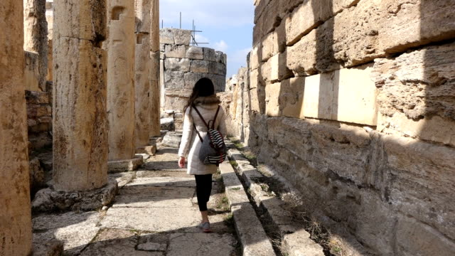 single woman is walking inside the hierapolis - athens greece stock videos & royalty-free footage
