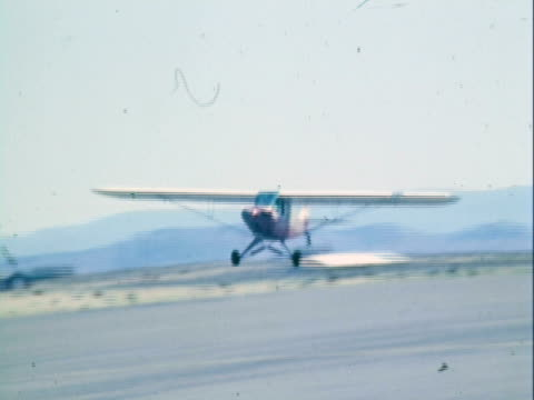 ts single-engine cessna towing glider taking off from airstrip / reno, nevada, united states - gliding stock videos and b-roll footage