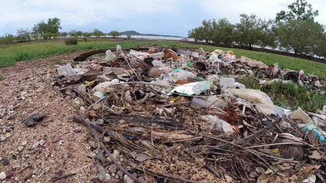 single-use plastic polluting coastline - ruined stock videos & royalty-free footage