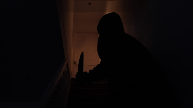 sinister silhouette of a man with a knife breaking in to a home - kitchen knife stock videos & royalty-free footage