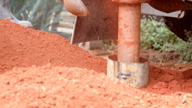 sinking a borehole in the garden - well structure stock videos and b-roll footage