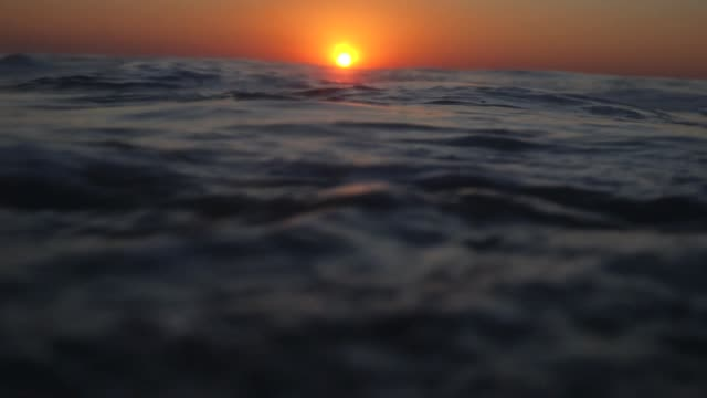 Sinking underwater at sunset