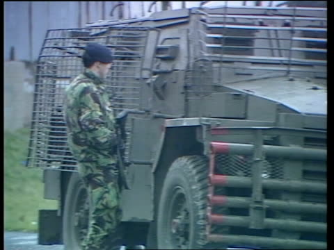 sinn fein conference / border security issue northern ireland belfast ext security troops on patrol in street massed police round ira funeral... - 北アイルランド点の映像素材/bロール
