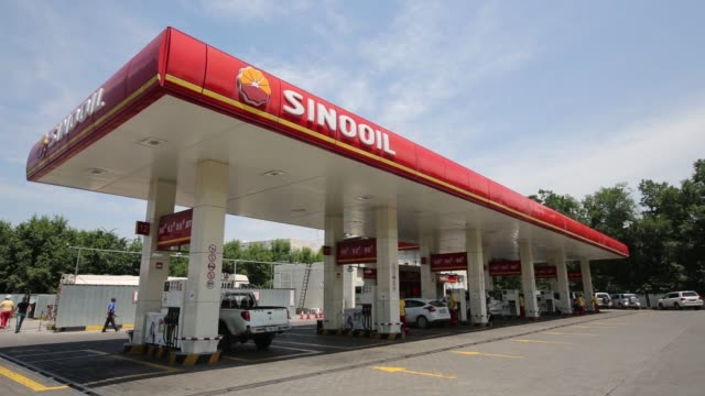 a sinooil logo sits above the forecourt of a gas station operated by sino oil gas holdings ltd in almaty kazakhstan on wednesday june 24 2015 shots... - logo stock-videos und b-roll-filmmaterial