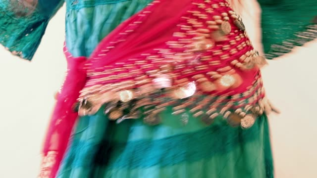 Sinti/Belly Dancer Studio Shot. Close up of hips