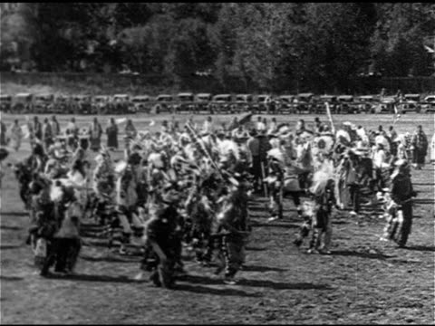 sioux nation native american peoples in traditional clothing dancing in field lined w/ cars ms dancing in celebration ws us president calvin coolidge... - headdress stock videos & royalty-free footage