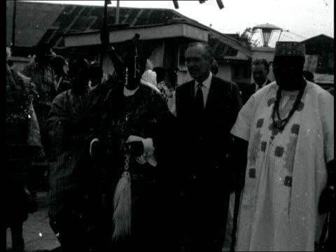sir alec douglas-home in nigeria; nigeria: agos: sir alec with the oba of lagos,adenigi adele: both towards: ditto: cms sir alec gets the tribal... - alec douglas home video stock e b–roll