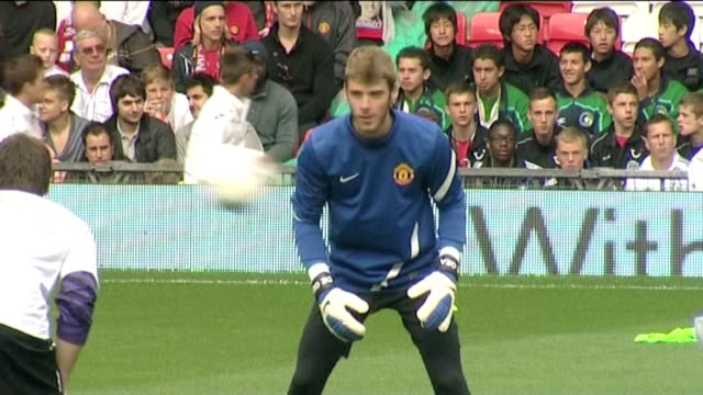 sir alecx ferguson signing autographs waving to fans wayne rooney fan pics and autographs and utd goalkeppers david de gea and anders lindegaard... - goalkeeper stock videos & royalty-free footage