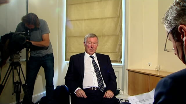 Ferguson interview ENGLAND London INT Sir Alex Ferguson chatting with reporter Mark Austin before interview SOT Sir Alex Ferguson interview SOT I...