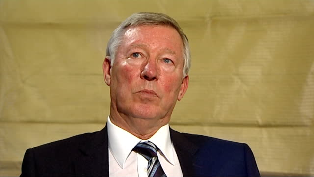 sir alex ferguson autobiography; london: int reporter reads section from book sot sir alex ferguson interview sot - he could have been in same... - autobiography stock videos & royalty-free footage