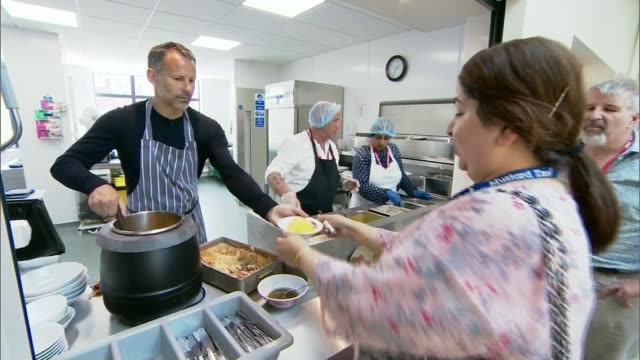 stockvideo's en b-roll-footage met ryan giggs sends get well message england int ryan giggs dishing up in kitchen giggs custard poured from ladle into bowl giggs handing bowl to woman... - soeplepel