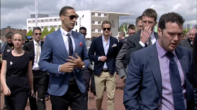 United players at Chester Races ENGLAND Cheshire Chester Chester Racecourse EXT Manchester United players along towards stands including Rio...