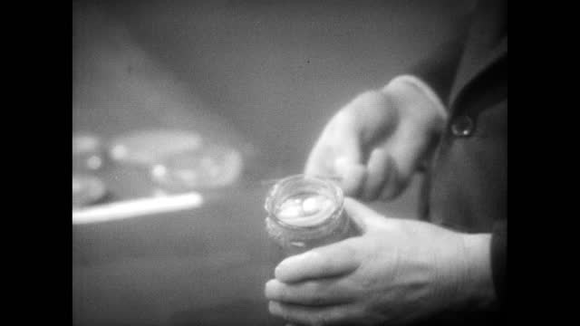 sir alexander fleming explaining mould growth on a jar of jam that has been open to the air. speculates it may be the same mould he found; jam jar1955 - 1950 stock videos & royalty-free footage
