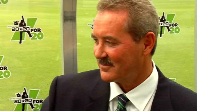 sir allen stanford interview; england: london: lord's: ext sir allen stanford talking to reporter set up shots for stanford interview stanford... - クリケット選手点の映像素材/bロール