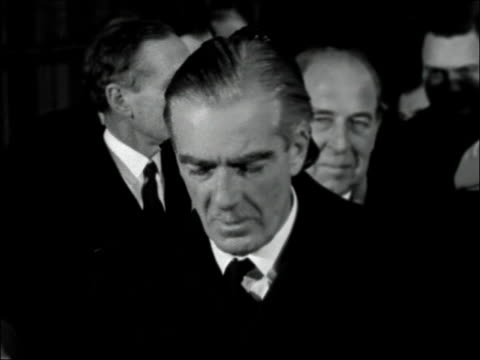 sir anthony eden leaves for new zealand england london royal albert docks ext gv 'rangitata' moored in dock / cu flag / name 'rangitata' on side of... - clarissa eden stock videos and b-roll footage