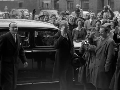 Sir Anthony Eden waves to the crowds after becoming the new Prime Minister of Great Britain