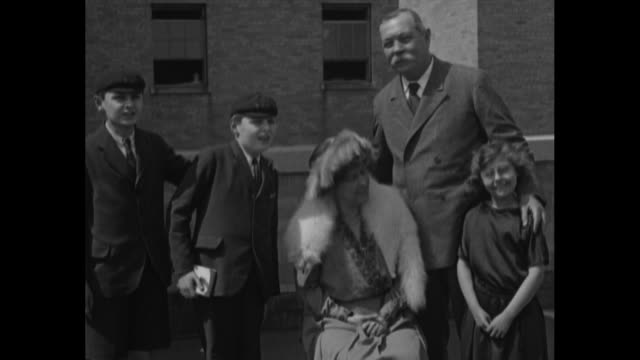 sir arthur conan doyle; his wife jean; two sons, denis and adrian; and daughter jean / doyle speaks about the possibility of communicating with the... - arthur conan doyle stock videos & royalty-free footage