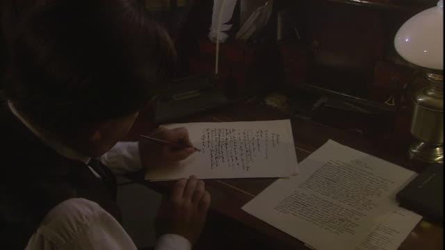 sir arthur conan doyle writes at a desk. - arthur conan doyle stock videos & royalty-free footage