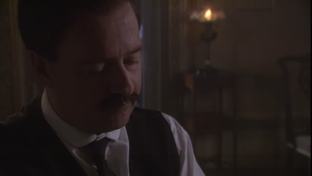 sir arthur conan doyle writes in a dimly lit room and looks up in contemplation. - historical reenactment stock videos & royalty-free footage